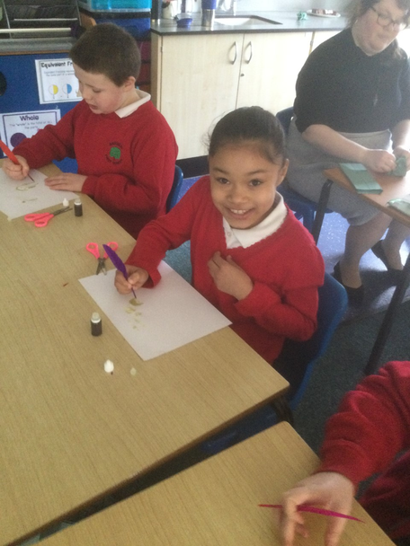 Writing with quills and ink we made ourselves.