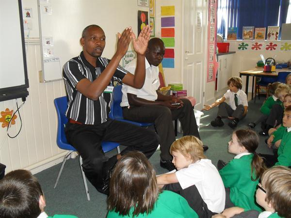Joseph and Kefa talking to children in Year 4