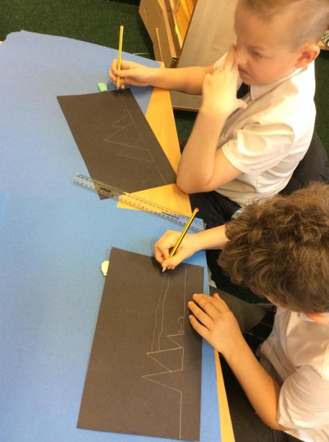 Carefully drawing our silhouettes.