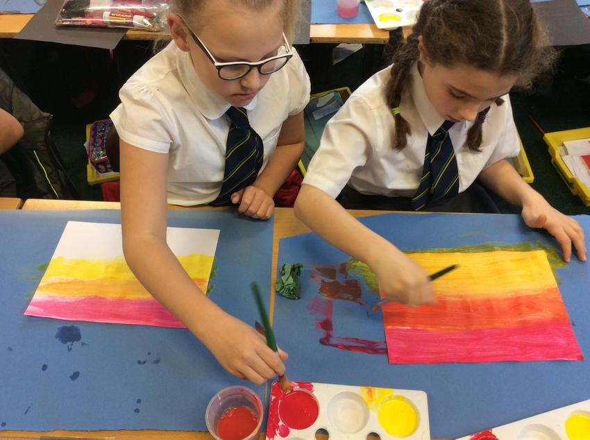We created a sunset using red and yellow.