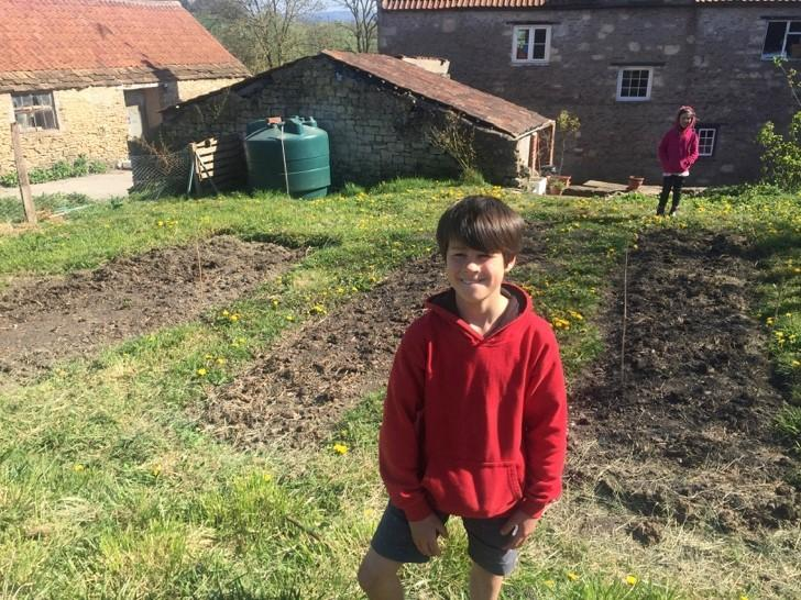 Wyn helping to dig his family's vegetable patch.