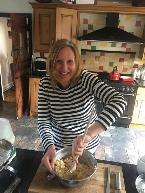 Mrs Simons mixing the cake mixture.