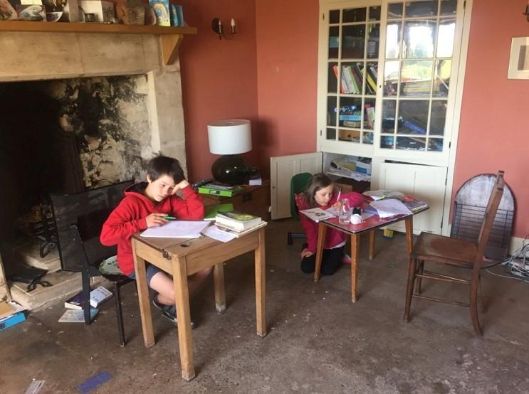 Wyn and Sybil learning English and Maths at home.