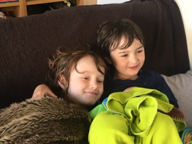Beau relaxing with his brother Luca.