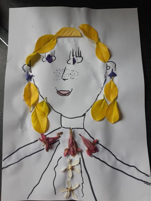 I love your use of petals to form a portrait!