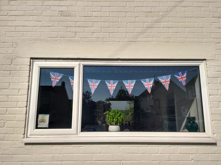 Decorating their window with homemade bunting!
