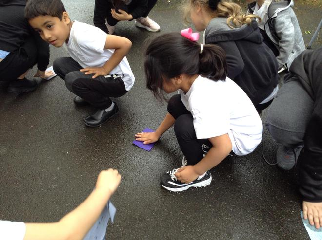 Here are the children testing out materials to see if they were strong. and durable.