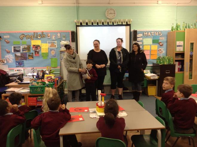 Here the class are handing the money to the BSA