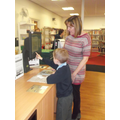 Using library card to borrow a  book.