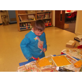 Rolling paint onto our printing blocks.
