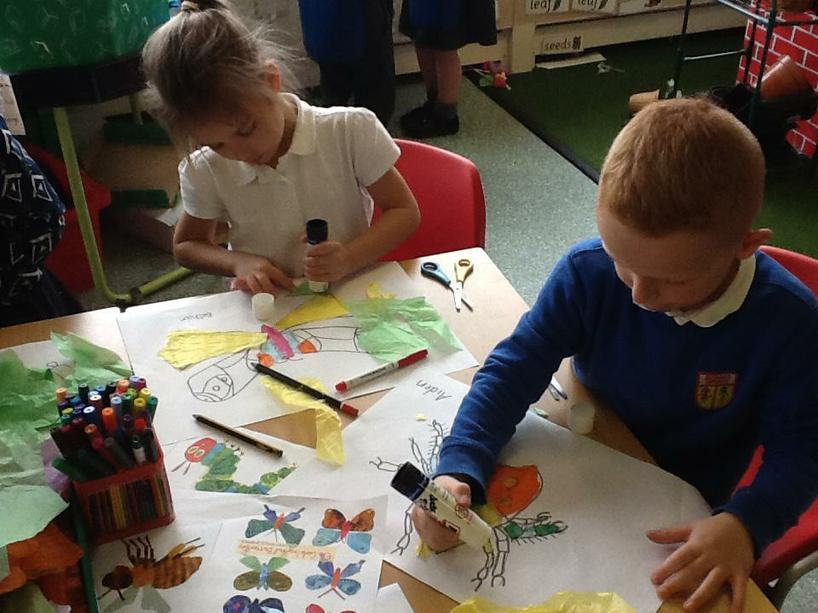 Adding colour to our sketches using tissue paper.