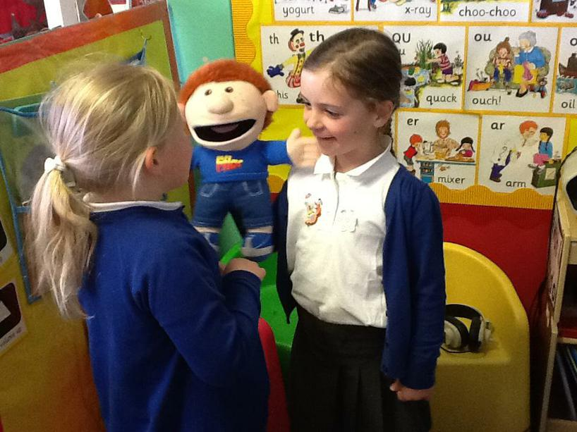 This is 'Fflac'. He helps us to speak using welsh.