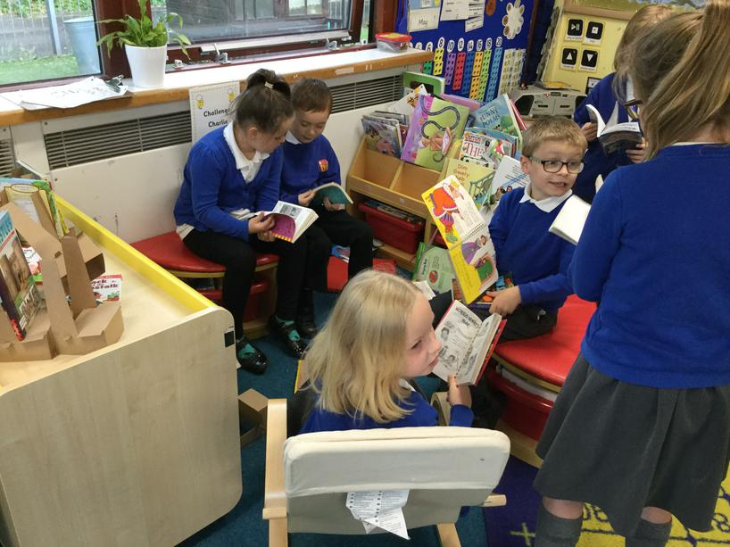 Sharing chapter books in the reading corner.