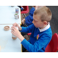 2. Making newspaper plant pots - biodegradable!