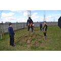 Year 6 children use the pond turf to make a mound