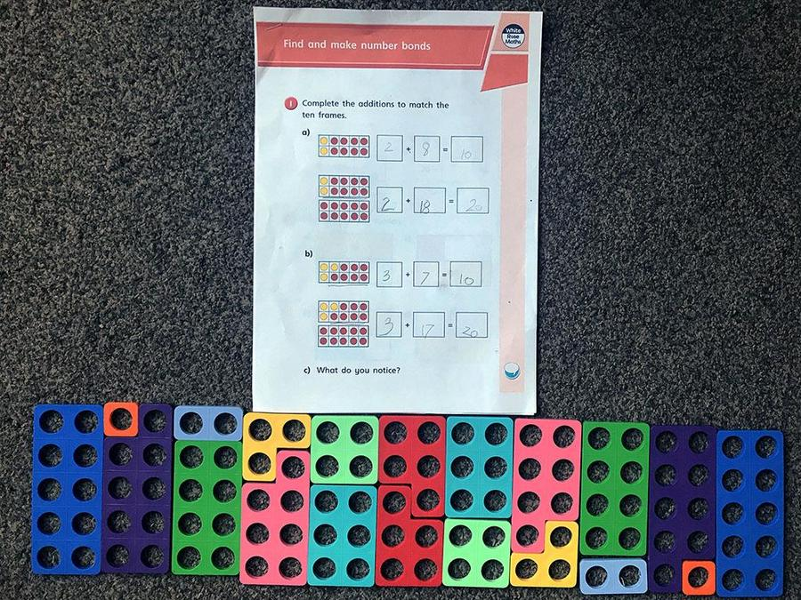 Alexis is busy at home using her numicon to help her learn number bonds.jpeg
