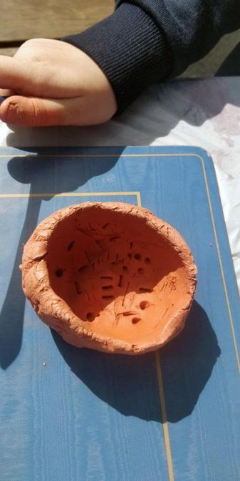 Harry and Oliver have enjoyed making some pots at home.jpg