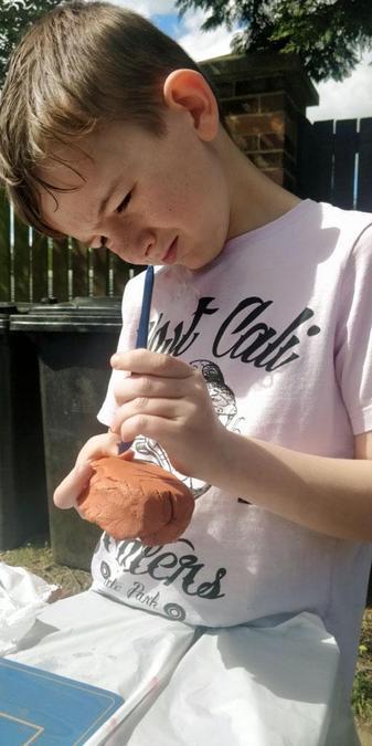 Harry & Oliver have enjoyed making some pots at home..jpg