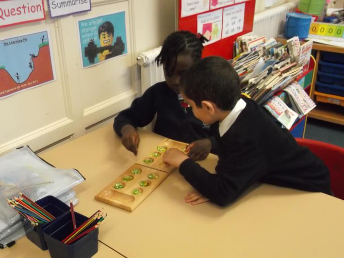 Mancala - an Ancient Egyptian game.