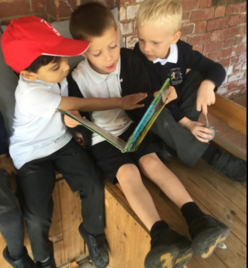 Boys choosing to share a familiar class favourite together outside.