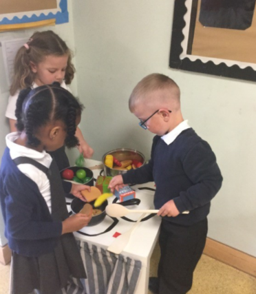 Making food to try with each other.