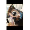 Amelia hard at work making mars bar cake.