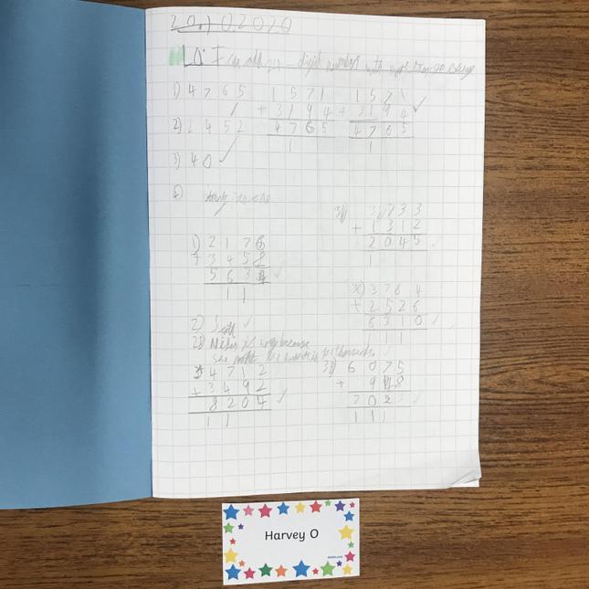 Harvey O's beautifully presented maths work.