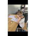Freddie doing his maths work