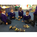Children sort objects during Maths into groups of big, medium, and small.