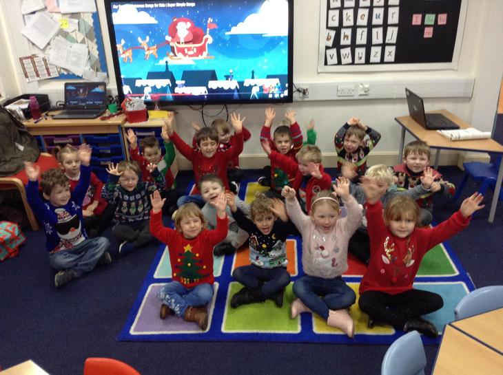 Class One wearing their Christmas jumpers.