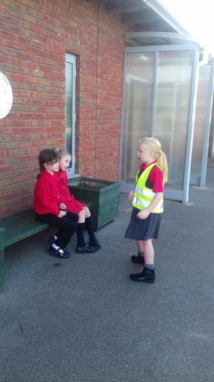 Talking to children at the Buddy Bus Stop.