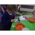Evie is igloo building.