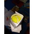 Tennis ball held!