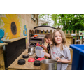 Cooking up something gooey in the mud kitchen