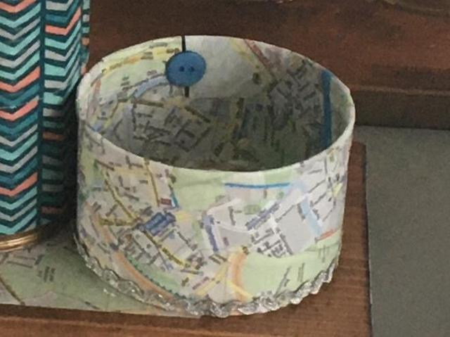 A pineapple tin decoupaged with a map