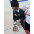 Using melted chocolate to represent molten rock.