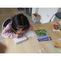 What book is Maariya using to help her today?