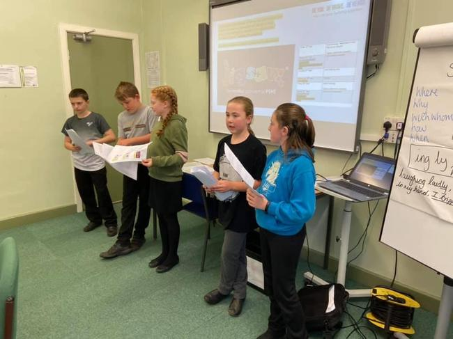 Anti-bullying team delivering a presentation on how we combat bullying in school