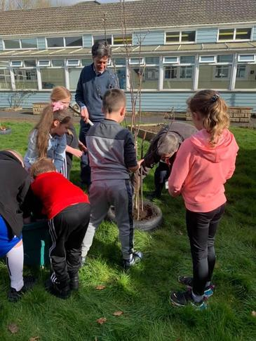 Children working on a project within the community creating a mental health garden