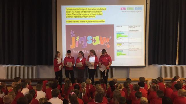 Anti-bullying team leading a whole school assembly