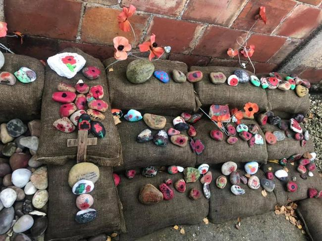 Children laying rocks of Remembrance at Eden Camp