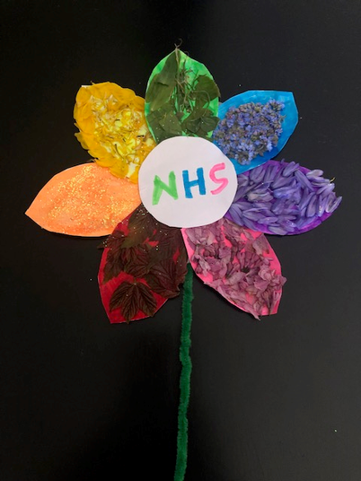 Lyla made this beautiful, collage flower.