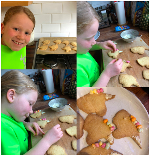 Lexie has made and decorated unicorn biscuits.