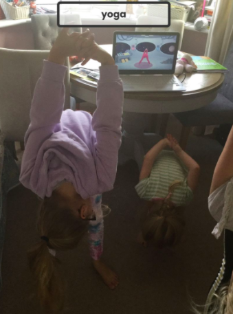 Elodie and her family doing yoga.