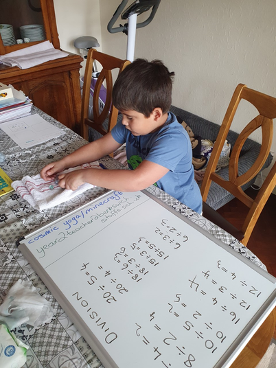 Logan used marbles to help him with division.