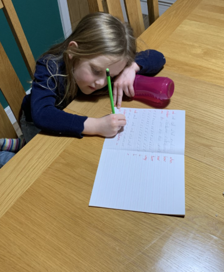 Lacey, working hard on her handwriting. Excellent!