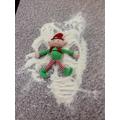 Elfie making snow angels