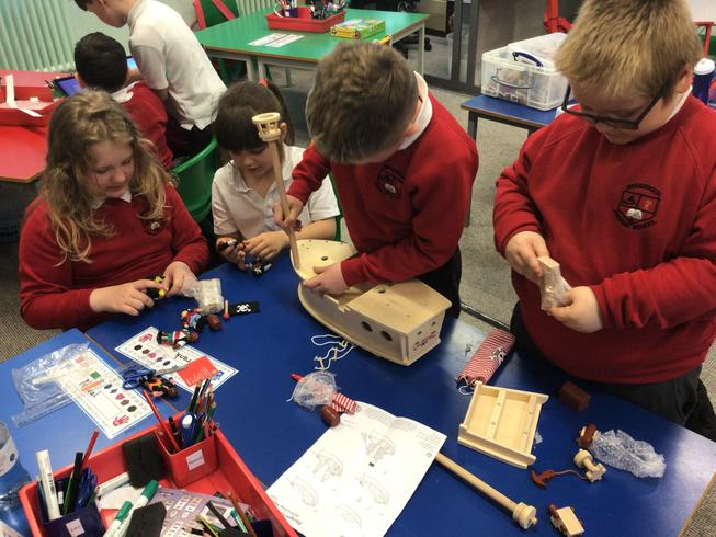 Following instructions to build a Pirate Ship.