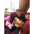 Mr Dryden reading whist loving his cat