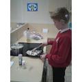Kyi is preparing a glazed chicken.